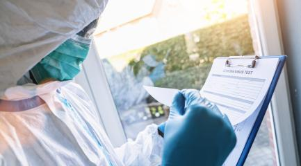 caregiver fills out a coronavirus test data sheet with pen in protective clothing in a clinic at Covid-19 coronavirus epidemic- Stock Photo or Stock Video of rcfotostock | RC-Photo-Stock