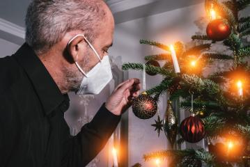 Caucasian Senior man wearing covid-19 mask in Christmas decorated room .  : Stock Photo or Stock Video Download rcfotostock photos, images and assets rcfotostock | RC-Photo-Stock.: