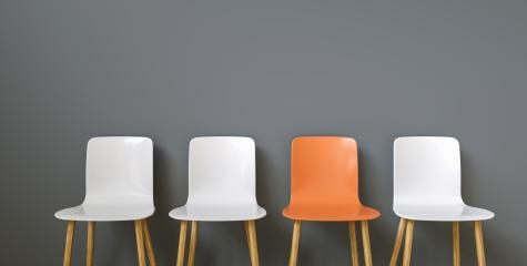 Chairs in a row arranged in front of a black wall, with copy space for individual text - Stock Photo or Stock Video of rcfotostock | RC-Photo-Stock
