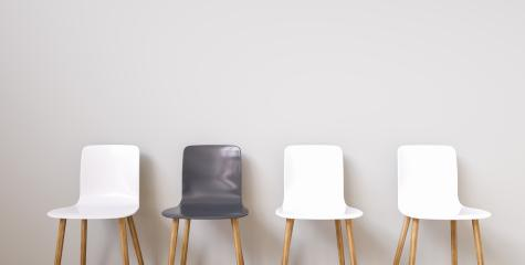 Chairs in modern design arranged in front of the wall for interior or graphic backgrounds. The chair in different color can be used as a metaphor to represent the hiring position.- Stock Photo or Stock Video of rcfotostock | RC-Photo-Stock