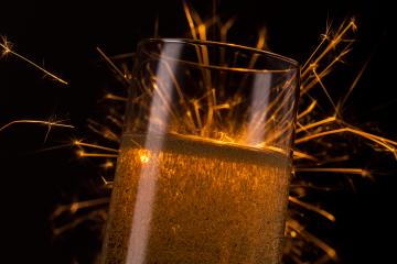 champagne glass with Ignited Sparkler - Stock Photo or Stock Video of rcfotostock | RC-Photo-Stock