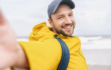cheerful bearded young man solo traveler taking selfie at the beach - Adventure wanderlust concept on the beach - Stock Photo or Stock Video of rcfotostock | RC-Photo-Stock