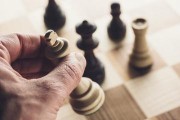 Chess game player makes a move the white king wins the game- Stock Photo or Stock Video of rcfotostock | RC-Photo-Stock