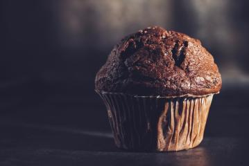 Chocolate muffin, homemade bakery on dark background, including copy space- Stock Photo or Stock Video of rcfotostock | RC-Photo-Stock