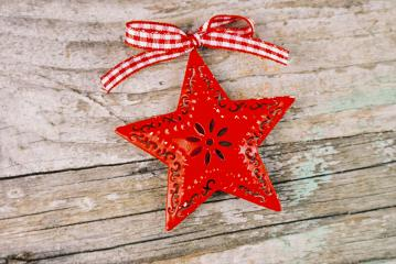 Christmas background with decorative red star and red bow : Stock Photo or Stock Video Download rcfotostock photos, images and assets rcfotostock | RC-Photo-Stock.: