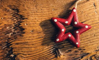 Christmas banner in greeting card style with red dotted Christmas star on a old wood board - Stock Photo or Stock Video of rcfotostock | RC-Photo-Stock