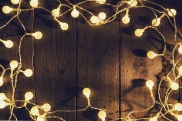 christmas lights on wooden planks,  with copyspace- Stock Photo or Stock Video of rcfotostock | RC-Photo-Stock
