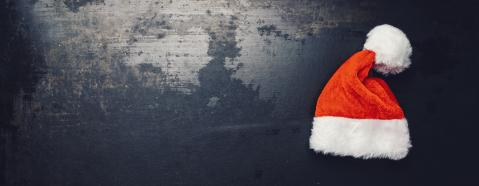 christmas santa hat on a dark surface, including copy space- Stock Photo or Stock Video of rcfotostock | RC-Photo-Stock