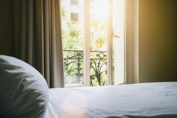 Classic bed in hotel room with a vintage look in paris- Stock Photo or Stock Video of rcfotostock | RC-Photo-Stock