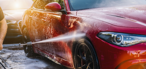 Cleaning red Car Using High Pressure Water in a Car Wash- Stock Photo or Stock Video of rcfotostock | RC-Photo-Stock