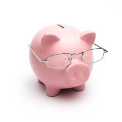 Clever Piggy Bank with Reading glasses- Stock Photo or Stock Video of rcfotostock | RC-Photo-Stock
