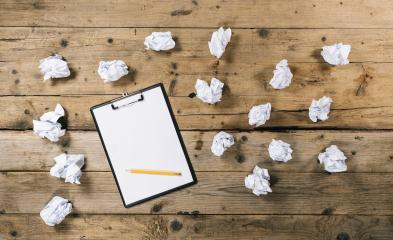 Clipboard with white sheet and pen with Crumpled paper balls on wood table background, copyspace for your individual text.- Stock Photo or Stock Video of rcfotostock | RC-Photo-Stock