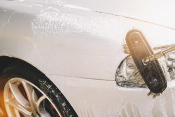 Close up detail of cleaning brush on car at carwash. copyspace for your individual text.- Stock Photo or Stock Video of rcfotostock | RC-Photo-Stock