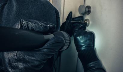 close up of a burglar with gloves picking a lock : Stock Photo or Stock Video Download rcfotostock photos, images and assets rcfotostock | RC-Photo-Stock.: