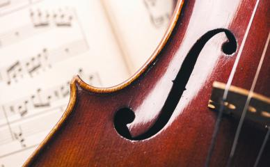 close up of an old violin on paper notes- Stock Photo or Stock Video of rcfotostock | RC-Photo-Stock