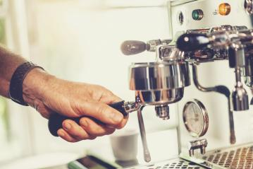 Close up of barista preparing fresh espresso on professional brewing machinery - Stock Photo or Stock Video of rcfotostock | RC-Photo-Stock