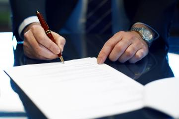 Close up of businessman signing a contract.- Stock Photo or Stock Video of rcfotostock | RC-Photo-Stock