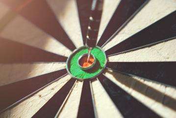 Close up of darts hitting the bulls eye on a dartboard- Stock Photo or Stock Video of rcfotostock | RC-Photo-Stock