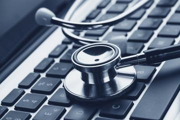 Close-up of a stethoscope on laptop keyboard- Stock Photo or Stock Video of rcfotostock | RC-Photo-Stock