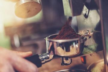 Close-up of barista grinding coffe in a coffeeshop- Stock Photo or Stock Video of rcfotostock | RC-Photo-Stock