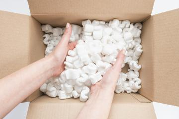Closeup of female hands digging in a heap of packing peanuts in a Box : Stock Photo or Stock Video Download rcfotostock photos, images and assets rcfotostock | RC-Photo-Stock.:
