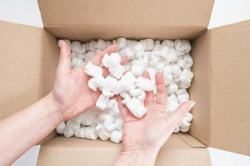 Closeup of female hands holding heap of packing peanuts in cardboard : Stock Photo or Stock Video Download rcfotostock photos, images and assets rcfotostock | RC-Photo-Stock.: