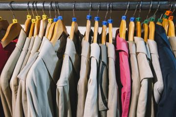 clothes for women or man hanging on hangers in shopping mall for store sale concept : Stock Photo or Stock Video Download rcfotostock photos, images and assets rcfotostock | RC-Photo-Stock.: