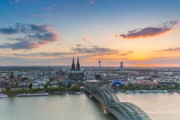 Cologne city with Cathedral at a cloudy sunset- Stock Photo or Stock Video of rcfotostock | RC-Photo-Stock