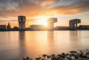 Cologne Crane Houses at Sunset on the rhine shore- Stock Photo or Stock Video of rcfotostock | RC-Photo-Stock
