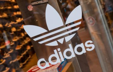 COLOGNE, GERMANY OCTOBER, 2017: Adidas logo on a store Window. Adidas Is a German multinational corporation that designs and manufactures sports clothing and accessories.- Stock Photo or Stock Video of rcfotostock | RC-Photo-Stock