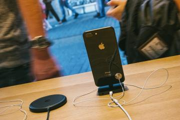 COLOGNE, GERMANY OCTOBER, 2017: presentation of the iPhone 8 and  Phone X in a Apple Store with reflection of street in glass facade with phones inside next to AirPower wireless charging.- Stock Photo or Stock Video of rcfotostock | RC-Photo-Stock
