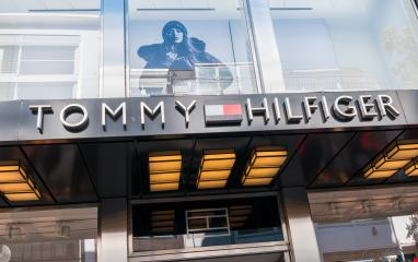 COLOGNE, GERMANY OCTOBER, 2017: Tommy Hilfinger logo on a store. Tommy Hilfiger is a global apparel and retail company founded in 1985 with over 1,400 stores in over 90 countries.- Stock Photo or Stock Video of rcfotostock   RC-Photo-Stock