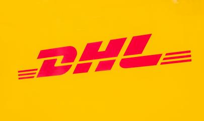 COLOGNE, GERMANY OCTOBER, 2017: Yellow DHL Logo on a truck. DHL Express is a division of the German worldwide logistics company.- Stock Photo or Stock Video of rcfotostock | RC-Photo-Stock