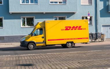 COLOGNE, GERMANY OCTOBER, 2017: Yellow DHL parcel delivery truck parked on the street. DHL Express is a division of the German worldwide logistics company. : Stock Photo or Stock Video Download rcfotostock photos, images and assets rcfotostock | RC-Photo-Stock.: