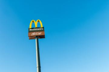 COLOGNE, GERMANY OCTOBER, 2017:McDonald's restauraunt sign against blue sky. The McDonald's Corporation is the world's largest chain of hamburger fast food restaurants.- Stock Photo or Stock Video of rcfotostock | RC-Photo-Stock