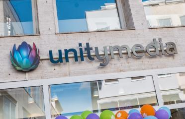 COLOGNE, GERMANY OCTOBER, 2017:Unitymedia shop logo. Unitymedia GmbH is a German cable network operator based in Cologne.- Stock Photo or Stock Video of rcfotostock | RC-Photo-Stock