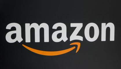 COLOGNE, GERMANY SEPTEMBER, 2017: Amazon Logo on black background. Amazon is an American electronic e-commerce company distribution worlwide.- Stock Photo or Stock Video of rcfotostock   RC-Photo-Stock