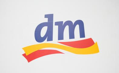 COLOGNE, GERMANY SEPTEMBER, 2017: Dm drogeriemarkt logo. Headquartered in Karlsruhe, Dm-drogerie markt is a chain of retail drugstore chain for cosmetics, healthcare and household products and food.- Stock Photo or Stock Video of rcfotostock | RC-Photo-Stock