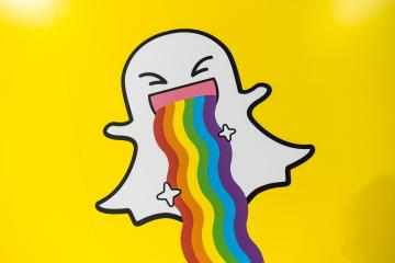 COLOGNE, GERMANY SEPTEMBER, 2017: Snapchat logo with rainbow printed on a paper wall. Snapchat is a popular social media application for sharing messages, images and videos. : Stock Photo or Stock Video Download rcfotostock photos, images and assets rcfotostock | RC-Photo-Stock.: