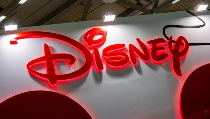 COLOGNE, GERMANY SEPTEMBER, 2019: Disney company logo sign at a trade show. The Walt Disney Company, commonly known as Disney, is an American mass media and entertainment company- Stock Photo or Stock Video of rcfotostock | RC-Photo-Stock