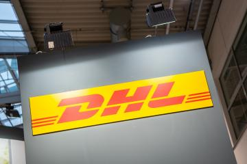 COLOGNE, GERMANY SEPTEMBER, 2019: Logo of DHL on a trade show booth. DHL is a division of the German logistics company. : Stock Photo or Stock Video Download rcfotostock photos, images and assets rcfotostock | RC-Photo-Stock.: