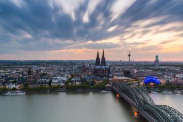 Cologne in germany at sunset with cloudy sky- Stock Photo or Stock Video of rcfotostock | RC-Photo-Stock