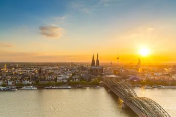 Cologne in Germany with the cathedral at sunset- Stock Photo or Stock Video of rcfotostock | RC-Photo-Stock