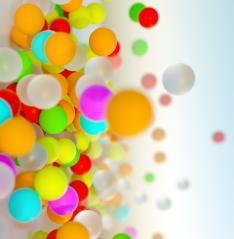 colorful bouncing balls outdoors against blue sunny sky- Stock Photo or Stock Video of rcfotostock | RC-Photo-Stock