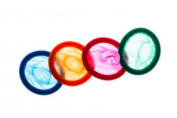 Colorful condoms on white- Stock Photo or Stock Video of rcfotostock | RC-Photo-Stock