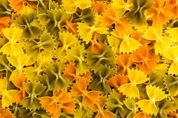 colorful Farfalle pasta noodles background- Stock Photo or Stock Video of rcfotostock | RC-Photo-Stock