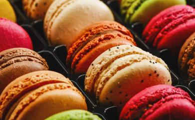 Colorful french macarons background, close up. Different colorful macaroons in Tasty sweet color - Bakery concept image- Stock Photo or Stock Video of rcfotostock | RC-Photo-Stock