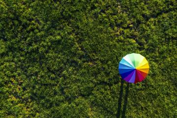 Colorful of umbrella on a green summer meadow - view from a drone- Stock Photo or Stock Video of rcfotostock | RC-Photo-Stock