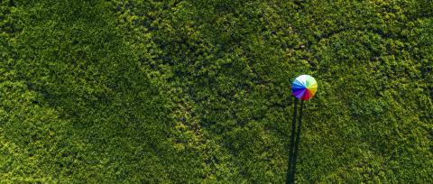 Colorful of umbrella on a green summer meadow, banner size - aerial drone shot- Stock Photo or Stock Video of rcfotostock | RC-Photo-Stock