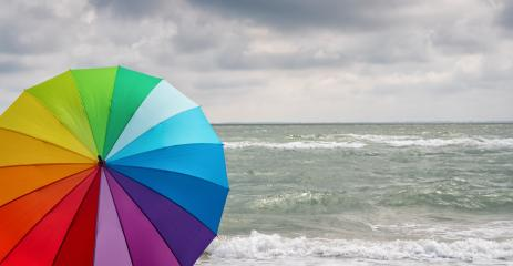 Colorful of umbrella on the beach and foam of sea waves at a thunderstorm, Weather concept image- Stock Photo or Stock Video of rcfotostock | RC-Photo-Stock